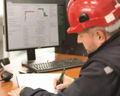 Construction Worker Using ViewpointOne on the Computer