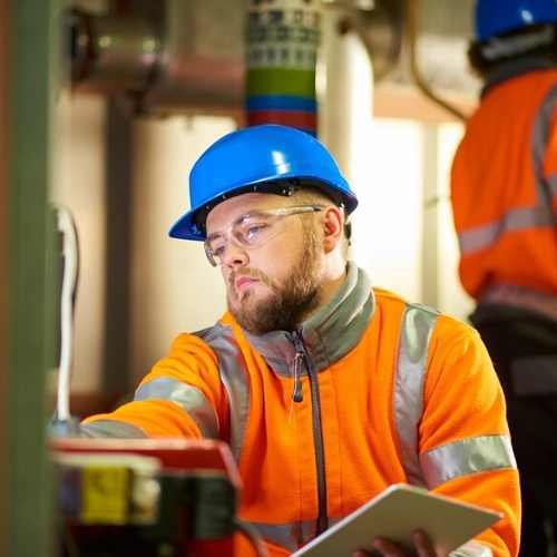 Service Technician Working on Site