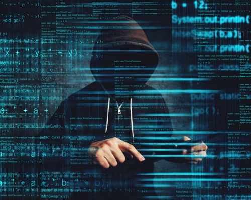 Man in Hood Posing as Cybersecurity Threat