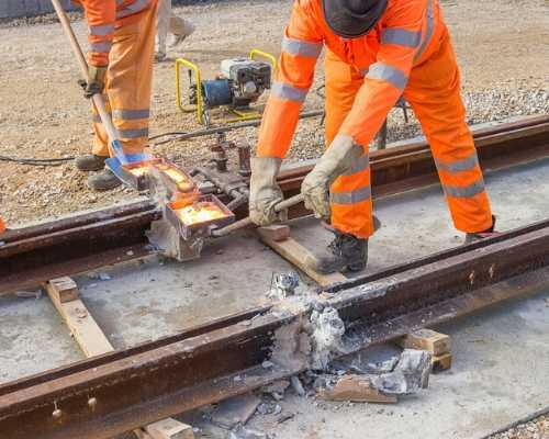 Construction workers building railroad.
