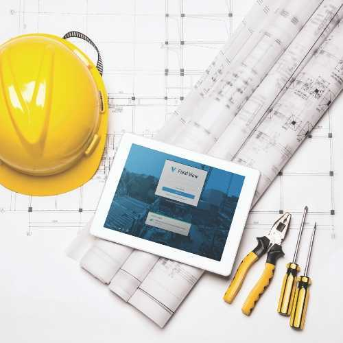 Tablet with Field View on Table Next to Construction Tools