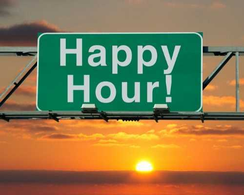 Happy Hour Sign with Sunset in the Background