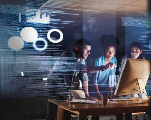 Workers Looking at Computer to Viewpoint Data and Diagrams