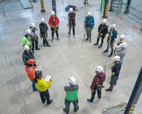 Group of construction workers gathered in a circle.