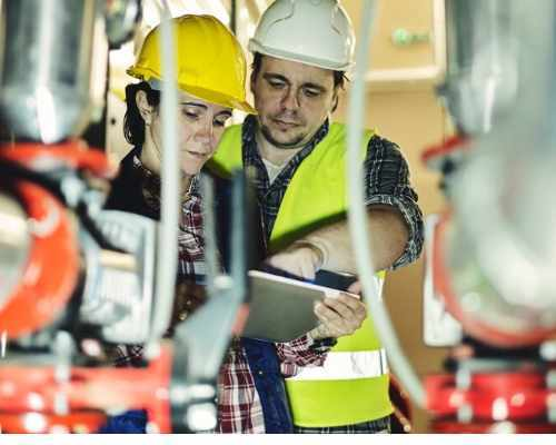 Two Construction Workers Looking at a Tablet