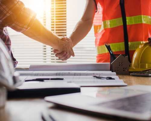 Construction Worker Shaking Hands with Other