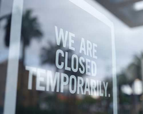Closed Sign in the Window of a Business