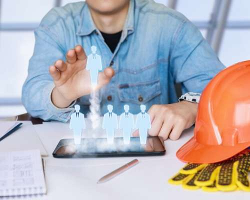 Construction worker managing HR resources on a tablet
