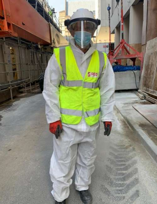 Construction Worker Wearing Safety Gear to Protect From Coronavirus