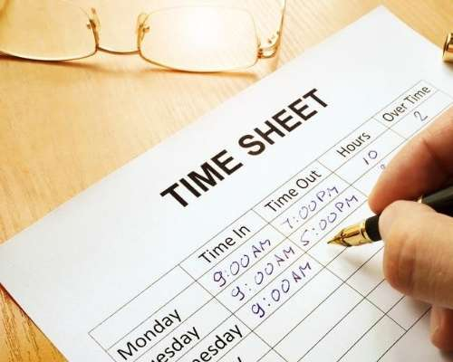 Time card sheet being filled out manually.